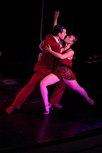 Adult Beautiful Woman Couple - Relationship Dancer Dancing Full Length Indoors  Lifestyles Love Night People Performance Posing Real People Red Romance Stage Costume Tango Dancers Togetherness Two People Women Young Adult Young Women Human Connection