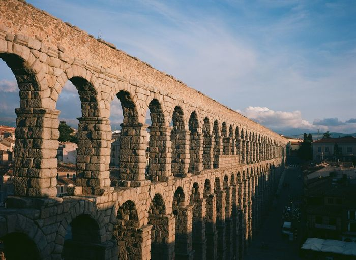 The aqueduct in Segovia, Spain. Ancient Ancient Civilization Aqueduct Arch Architecture Built Structure Day Famous Place Film Photography History International Landmark Old Old Ruin Outdoors Roman Ruins Segovia Sky SPAIN The Past Tourism Travel Travel Destinations