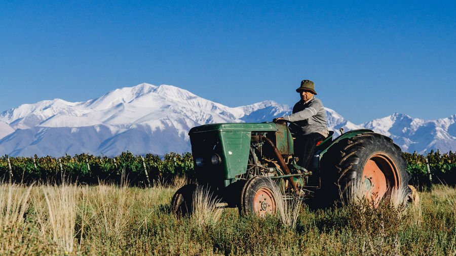 What a view with that amazing old tractor in scene. Argentina Day Landscape Mendoza Mountain Mountain View Mountains Nature Old Outdoors Tractor Vineyard Wine Moments