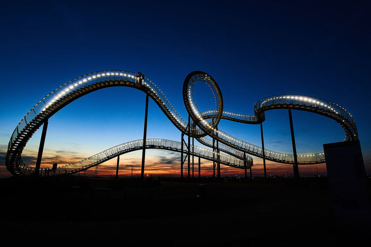 Tiger And Turtle Tiger And Turtle – Magic Mountain Magic Mountain Duisburg Ruhrgebiet Sunset Roller Coaster Rollercoaster Low Angle View Silhouette Metal No People