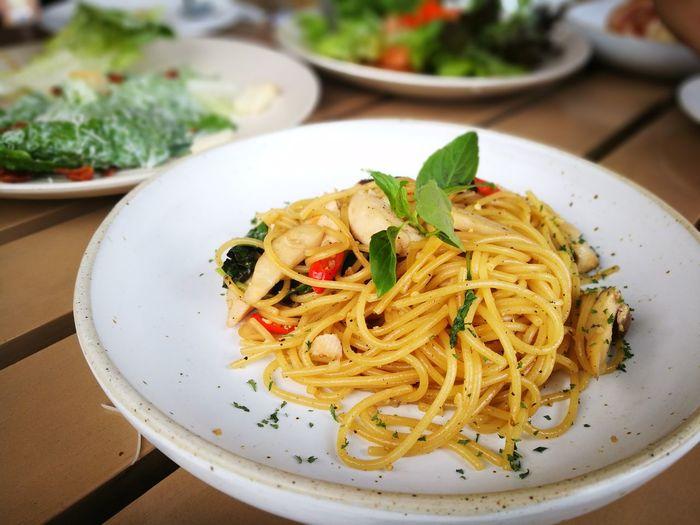 Spaghetti spicy chicken Italian Food Plate Herb Savory Food Appetizer Pasta Close-up Food And Drink Pesto Sauce Spaghetti Garlic Basil Sauce Parsley Garlic Clove Feta Cheese Oregano