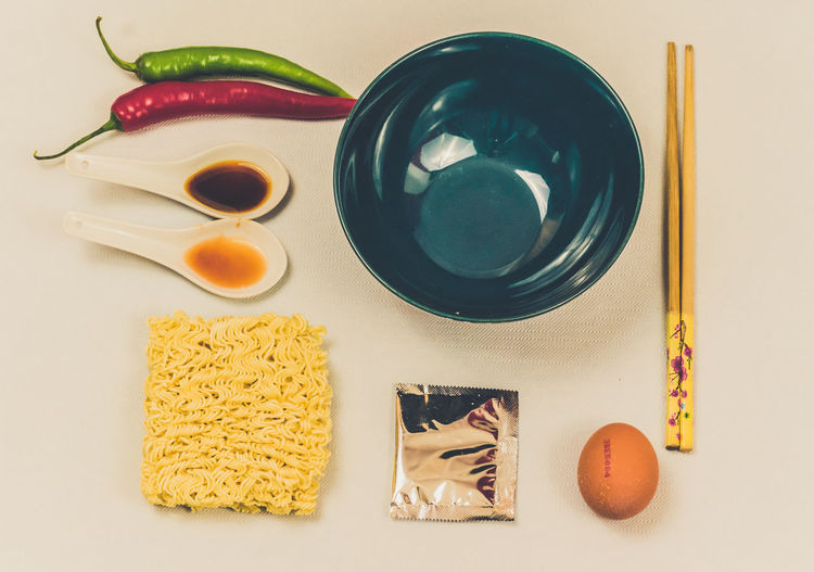 Directly Above Indoors  No People Close-up Day Meal Copy Space Noodles Preparing Food Beautifully Organized Dishes Ready-to-eat Decomposed Pasta Spices Chopsticks Egg Bowl Dry Noodles White Background Freshness Chili Pepper Food Full Frame Soya Sauce