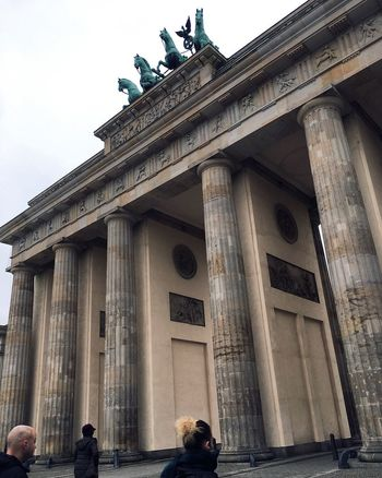 Architecture Built Structure Building Exterior Real People Travel Destinations History Low Angle View Architectural Column Tourism Day Travel Men Large Group Of People Leisure Activity Statue Outdoors Women City Gate Sculpture City Berlin Branderburgertor