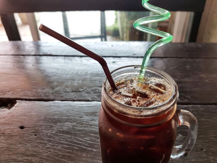 a glass of iced americano - refreshing drink Beverage Caffeine Espresso Frozen Mocha Americano Coffee Aroma Black Coffee Mug Cafe Coffee Drink Food And Drink Glass Ice Coffee Jar Jug