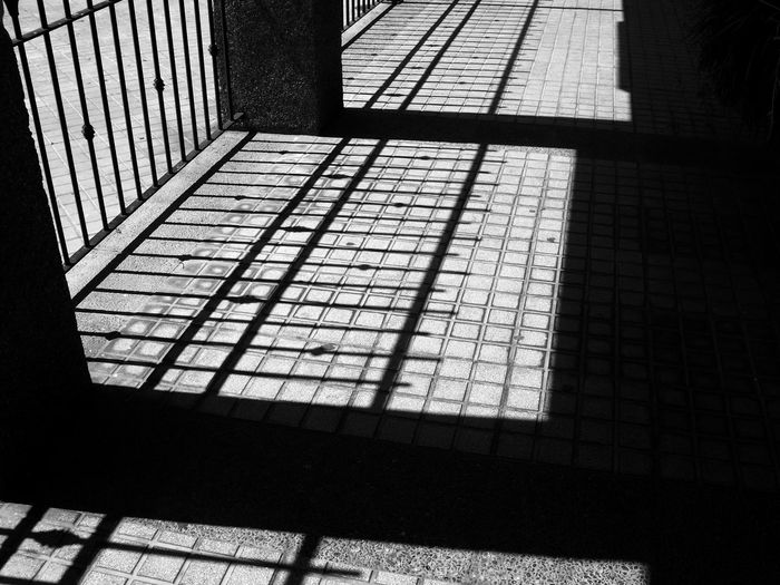 Shadows & Lights Architecture Balck And White Blackandwhite Building Dark Day Flooring Focus On Shadow Footpath High Angle View Indoors  Monochrome No People Pattern Railing Shadow Staircase Sunlight Tile Tiled Floor Window