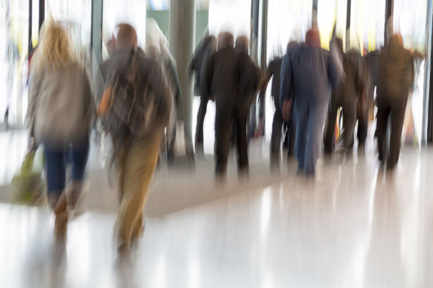 People stream in modern interior, motion blur Adult Adults Only Blurred Motion Business Businesspeople Commuter Corporate Day Indoors  Large Group Of People Men Motion Office Office Building People Person Rear View Rush Hour Rushing Shop Shopping Unrecognizable People Urgency Walking Women