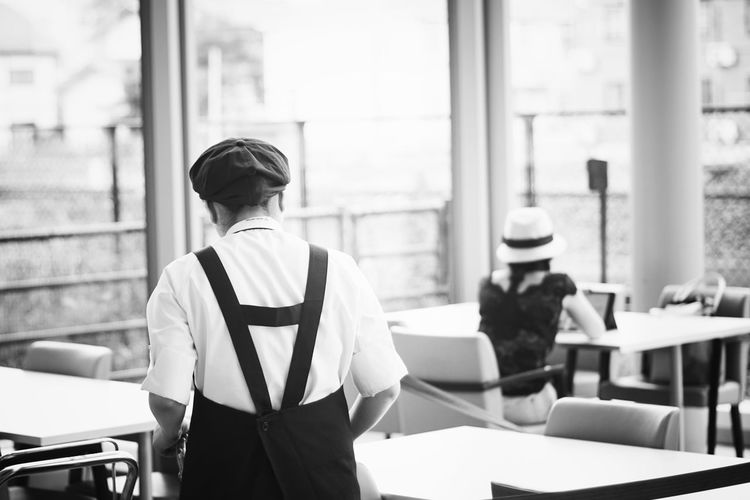 Rear view of waitress at restaurant