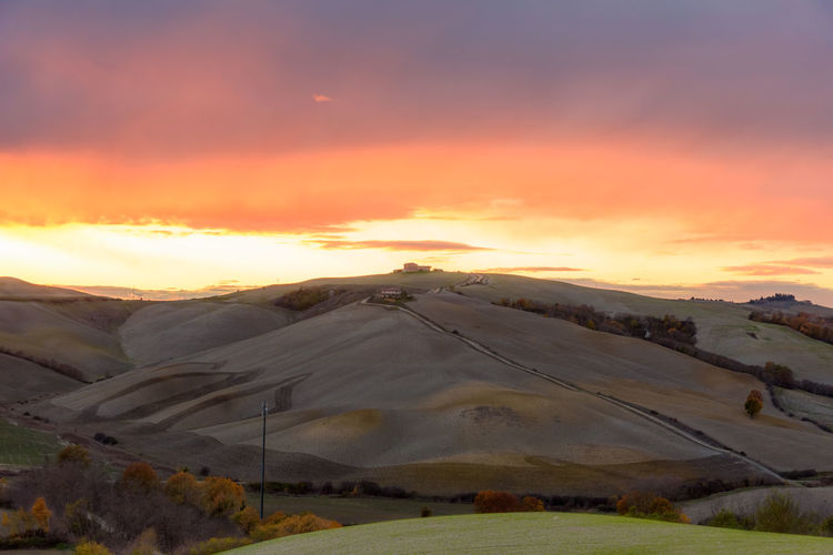 Crete Senesi Torre A Castello Tuscany Tuscany Countryside Beauty In Nature Cloud - Sky Day Europe Field Italian Landscape Mountain Nature No People Orange Color Outdoors Scenics Siena Sky Sunset Tranquil Scene Tranquility