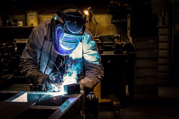 Welder welding at workshop