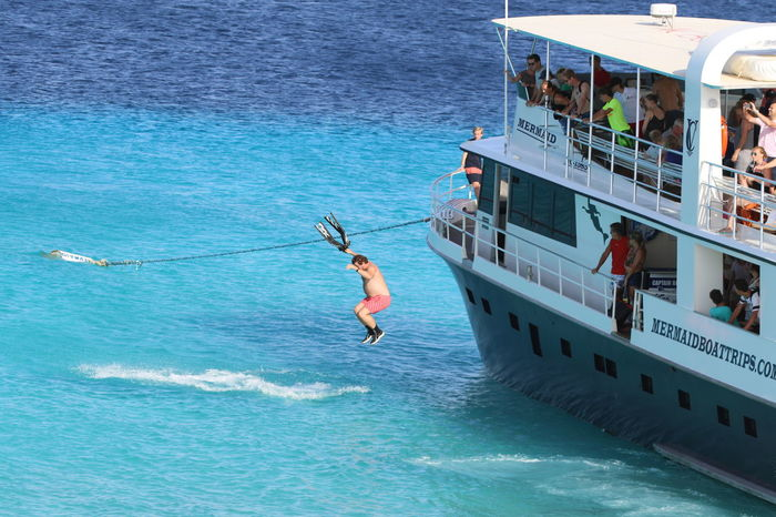 Adventure Boat Caribbean Sea Journey Jumping Klein Curacao Leisure Activity Lifestyles Men Nautical Vessel Sea Shirtless Summer Tourism Tourist Transportation Vacations Water Waterfront