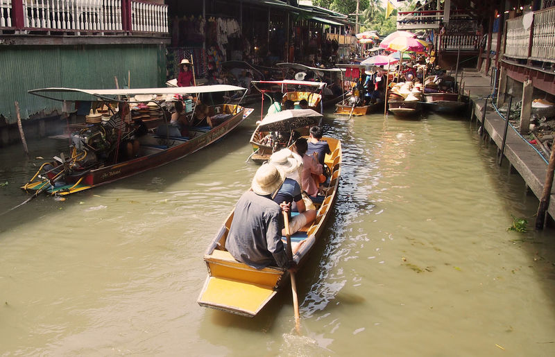 visiting the Damnoen Saduak Floating Market near Bangkok ASIA Backpacking Damnoen Saduak Floating Market South East Asia Thailand Tourist Attraction  Travel Traveling Wanderlust Adult Architecture Building Exterior Built Structure Canal Damnoen Saduak Day Floating Market Gondola - Traditional Boat Group Of People Large Group Of People Mammal Men Mode Of Transport Nautical Vessel Near Bangkok Oar Occupation Outdoors People Real People Rowing Sitting Thailand_allshots Thailandtravel Tourism Transportation Travel Destinations Water Women