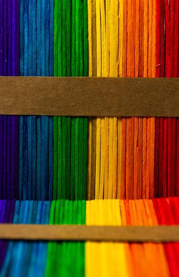Full frame shot of multi colored tongue depressors