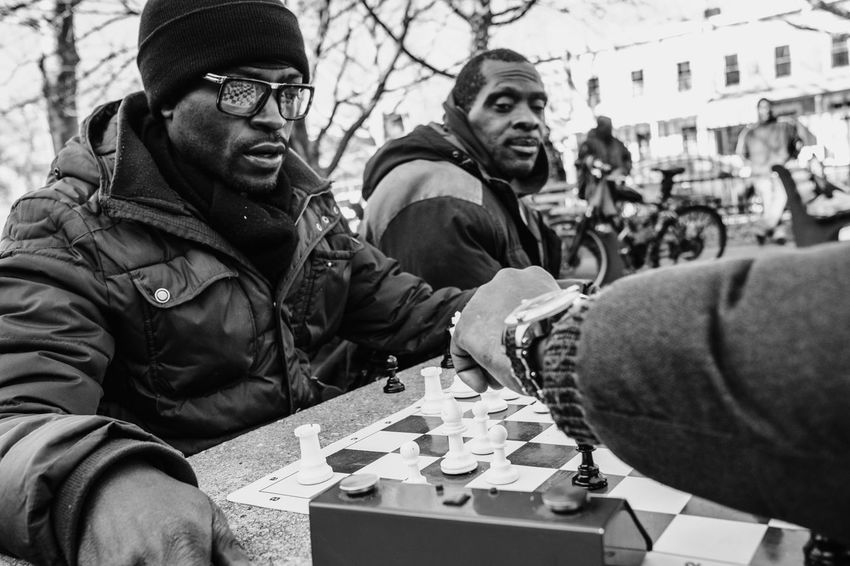 Brooklyn | New York City, 2017 Black & White Brooklyn Documentary Photography New York New York City Reflection Travel Photography Balck And White Blackandwhite Blackandwhite Photography Chess Lifestyles Move Outdoors People Playing Real People Reportage Street Chess Street Photography Streetphotography Travel Street Photography