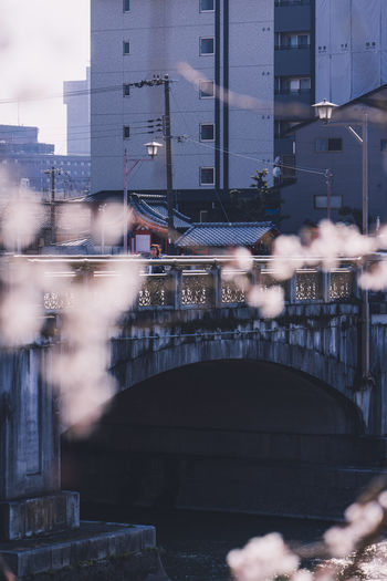 Blurred motion of bridge over buildings in city