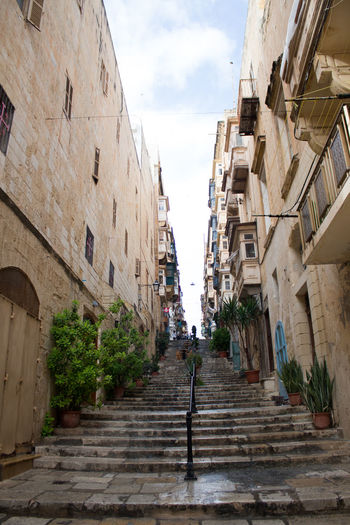 Architecture Built Structure Building Exterior Staircase Sky City Building Cloud - Sky The Way Forward Direction Nature Residential District Steps And Staircases Day Street Incidental People Low Angle View Plant Narrow Outdoors Alley Valetta Valetta,Malta Houses And Windows