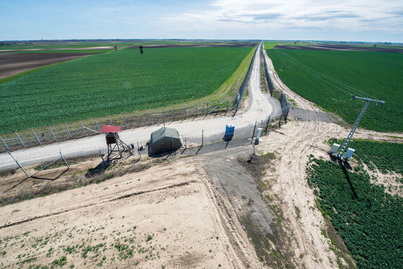 Hungarian Border Hungary Agriculture Barrier Beauty In Nature Border Border Barrier Border Fence Cloud - Sky Day Environment Fence Field Hungarian Border Fence Land Land Vehicle Landscape Men Military Mode Of Transportation Nature Outdoors Real People Road Rural Scene Scenics - Nature Sky Transportation Working