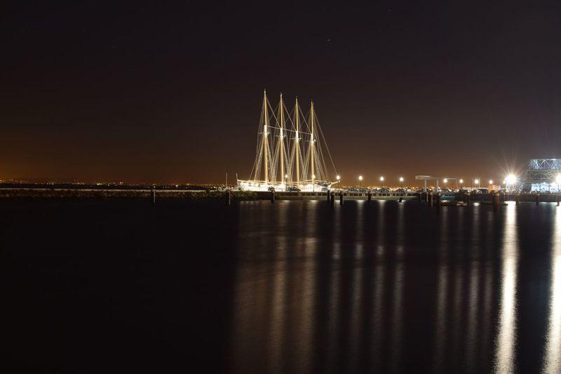 Night Sea Reflection Illuminated Sky Water No People Outdoors Beach Architecture Nature