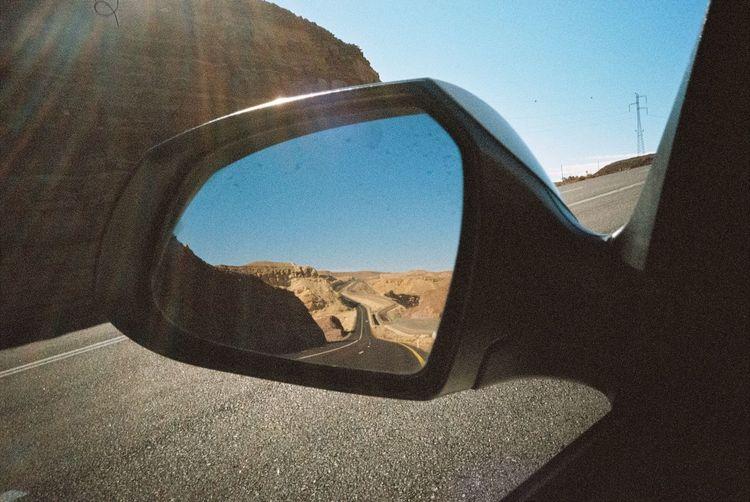Reflection of sky on car window