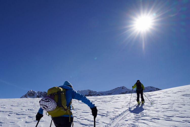 Mountaineering Winter Sport Leisure Activity Clear Sky Sun Mountain Range Snowcapped Mountain Outdoors Real People