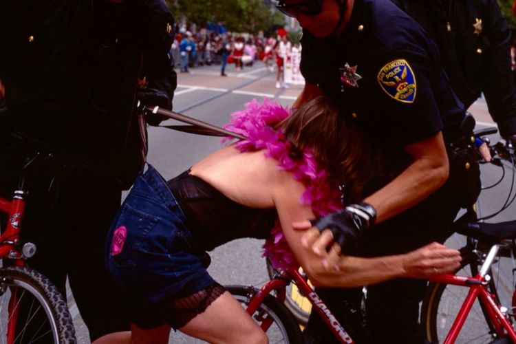 Acting Up   San Francisco - an Act Up protester is arrested after throwing at anti-gay congregants of the Rev. Fred Phelps.