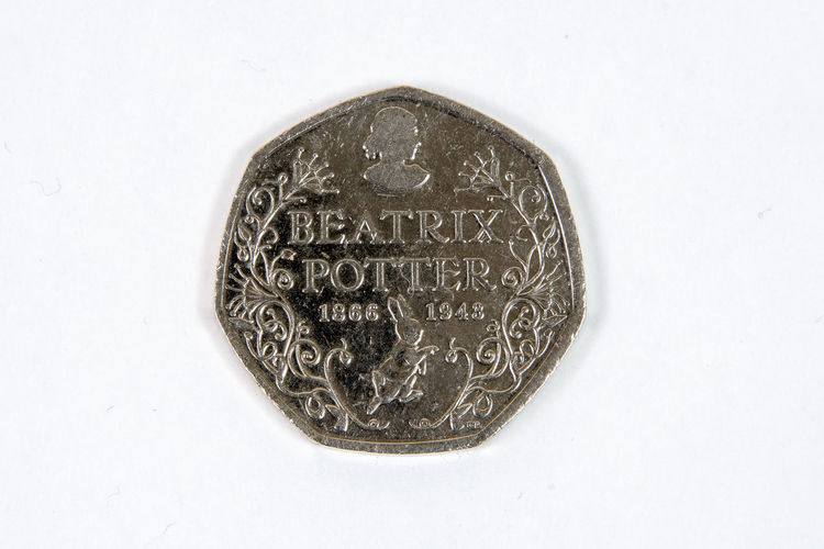 Limited edition United Kingdom fifty pence coin Beatrix Potter United Kingdom Architecture Beatrix Business Circle Close-up Coin Currency Directly Above Edition Fifty Finance Geometric Shape Indoors  Limited Metal No People Number Pence Studio Shot Text Wealth White Background White Color
