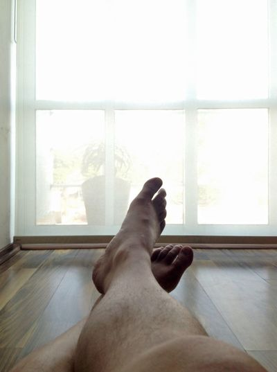 Sitting on the floor in front of a French window Window Light French Legs Feet Male Sitting Floor Morning Relaxing