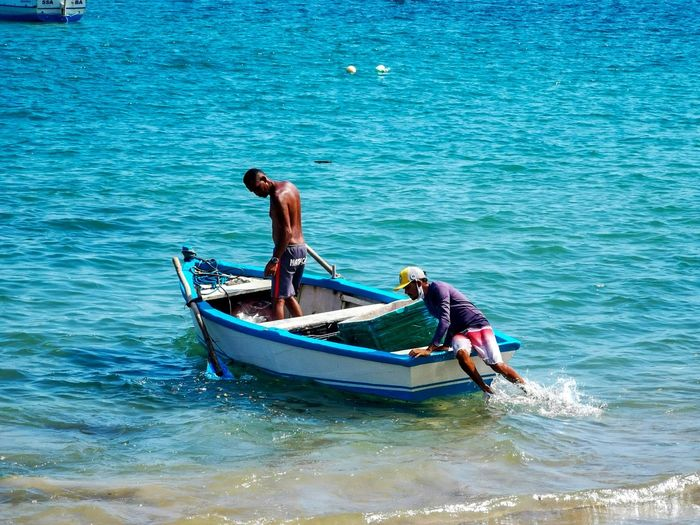 Men in boat on sea