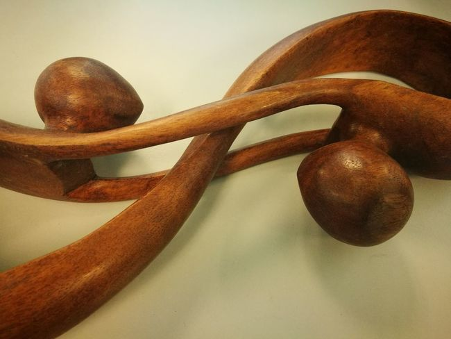 Love each other Connection Two Hearts Two Hearts Became One Sculpture Close-up Indoors  Wood - Material No People Still Life Brown Sport Leisure Activity Two Objects Lifestyles Antique Studio Shot