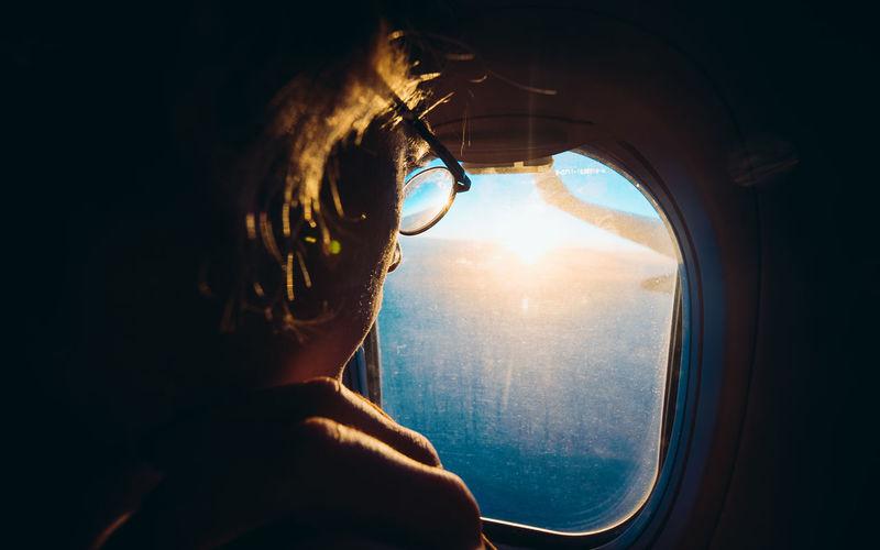 Portrait of man seen through airplane window