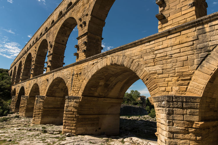 Ancient Ancient Civilization Aqueduct Arch Architecture Built Structure Day France History Low Angle View Nature No People Old Ruin Outdoors Pont Du Gard Provence Provence-Alpes-Cote D'Azur Sky Sunlight Travel Destinations