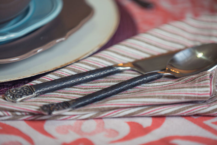 Country Living Fabric Texture Table Setting Close-up Day Indoors  Interior Design Mixed Colors No People Organic Pattern Plate Stainless Steel  Still Life Table Tablecloth Texture Utensils