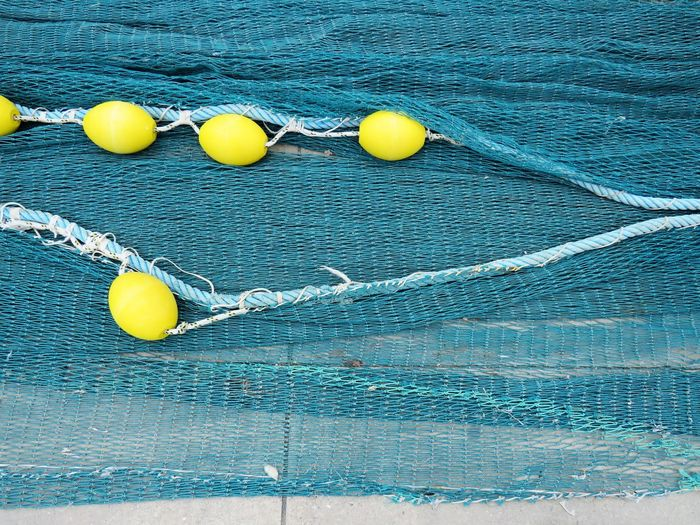 Background Backgrounds Blue Buoy Close-up Day Float Floating Floating On Water High Angle View Inflatable  Nature No People Outdoors Pool Rope Sea Still Life Swimming Pool Turquoise Colored Water Waterfront Yellow