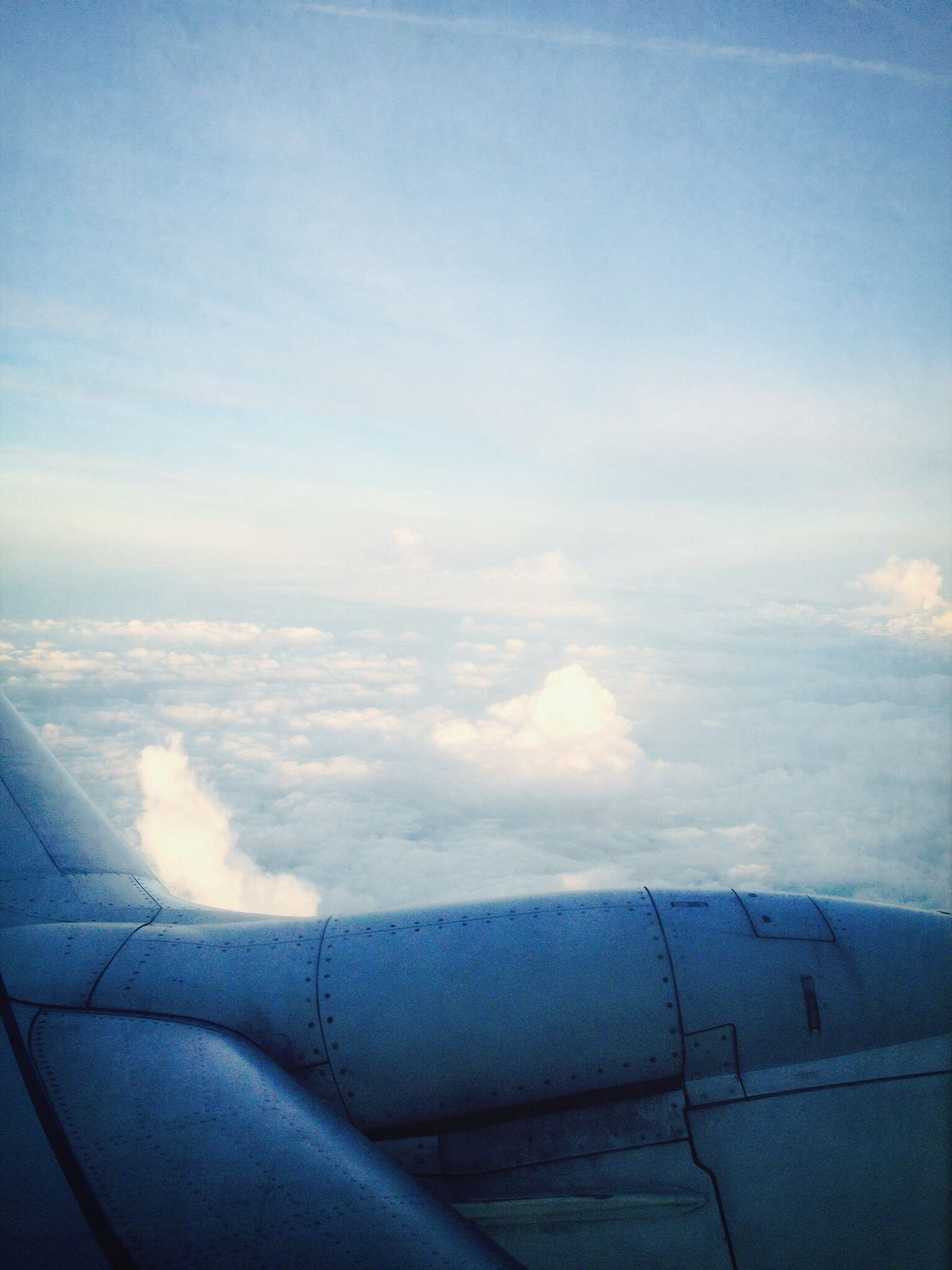 airplane, transportation, air vehicle, mode of transport, sky, aerial view, aircraft wing, part of, cloud - sky, flying, cropped, journey, landscape, travel, scenics, cloud, cloudscape, beauty in nature, vehicle interior, nature