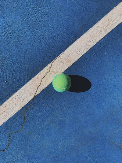 High angle view of green ball on bed