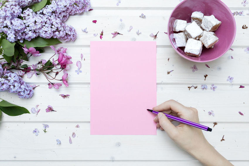 White tabletop scene with female hand writing on a blank pink paper Blank Pink Paper Blank Space Bloggers Female Hand Female Hand Writing Flat Plain Flower Image For Bloggers Image Of Social Network Istock Styled Photo Mock Up Mockup Scene Pen Pink Color Pink Colors Ship Deck Tabletop Stock Photo Styled Stock Table Tabletop Tabletop Scene Tabletopphotography View From Above Water White Table