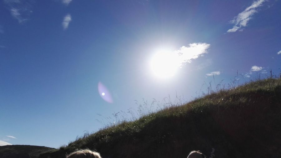 Beauty In Nature Blue Countryside Grass Lens Flare Mountain Outdoors Sun Sunlight Tranquility