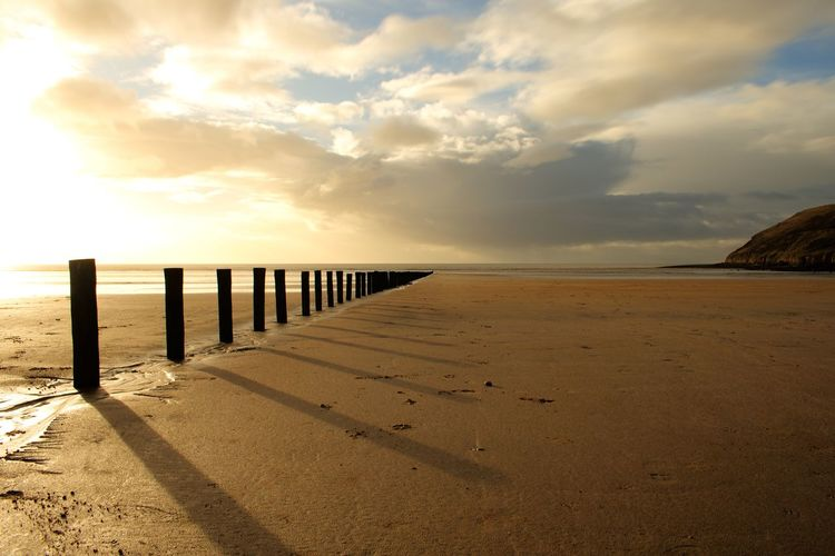 Long Exposure Sky Sea Beach Cloud - Sky Sand Scenics Tranquility Tranquil Scene Horizon Over Water Sunlight No People Nature Water Beauty In Nature Outdoors Sunset Day