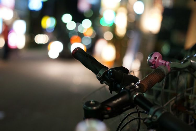 Cropped Image Of Bicycles On Street At Night