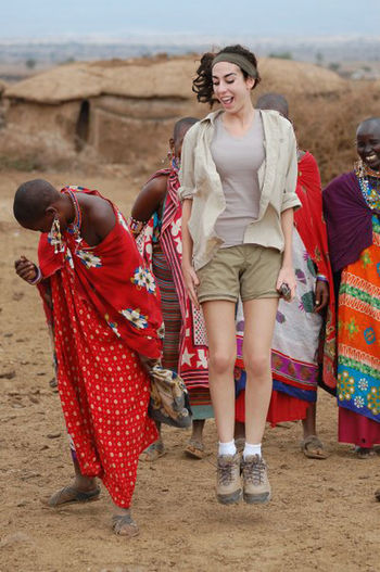 Africa Contrast Custom Humans Jump Laughing Lifestyles Live Love Masai Tribe Participating Perspective Portrait Real People The Human Condition Traveling Tribe Universal Language Unspoken Young Women