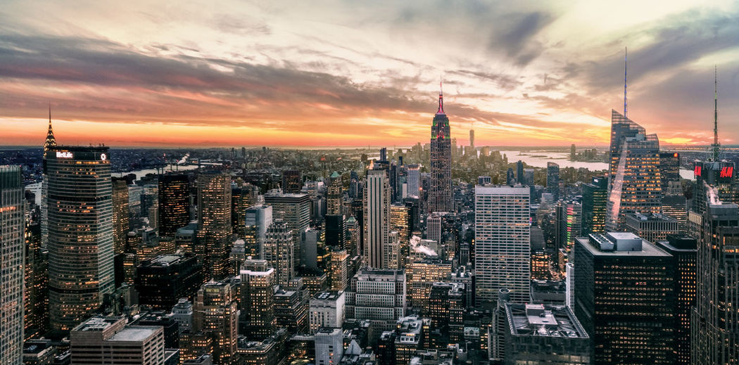 A picture taken on my phone (one plus three) at the top of the Rockefeller Center in New York. America Architecture Building Exterior City Cityscape Cloud - Sky Day Empire State Building Manhattan Modern New York New York City No People One Plus 3 One Plus Three Outdoors Phone Photography Sky Skyline Skyscraper Sunset Tower Travel Destinations Urban Skyline World Trade Center