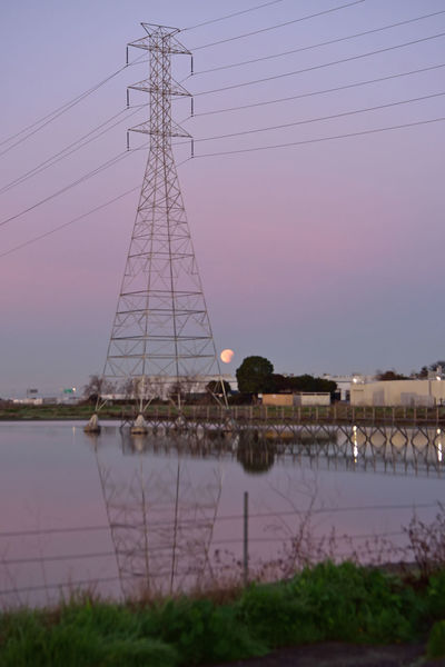 Super Moon Sets 5 Hayward, Ca. Eden Landing Ecological Reserve Super Moon Trilogy Blood Moon Blue Moon. Full Moon Lunar Eclipse Dawn Daybreak Sunrise Moon_collection Sunrise_Collection Power Pylon Power Lines Catwalk Reflections Reflected Glory Reflections In The Water Nature Beauty In Nature Nature_collection Landscape_Collection Landscape_photography Astronomy Celestial Cosmic Luminance Penumbra Umbra Super Moon 2018