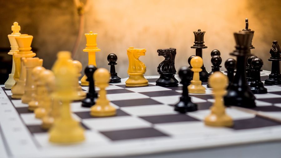 Close-up of chess board on table