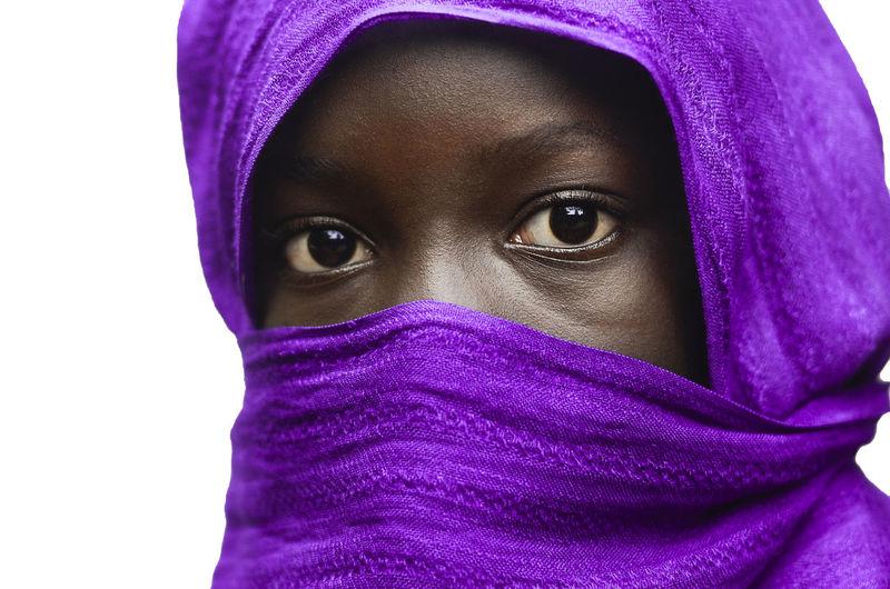 Close-up portrait of purple covering face