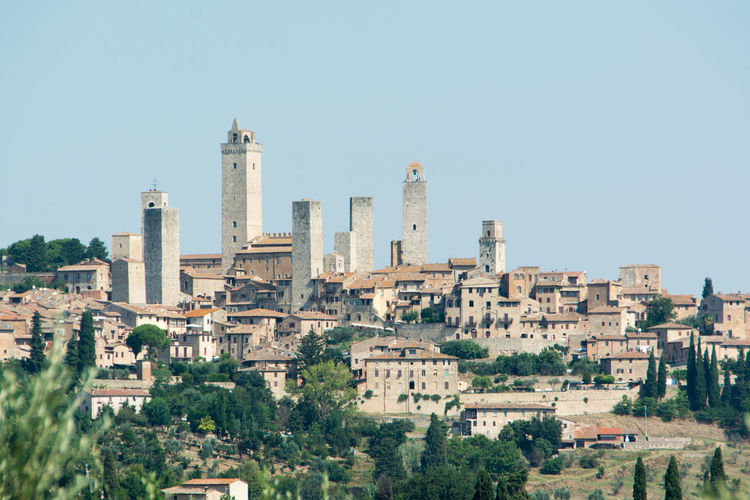 view to the towers of san gimignano San Gimignano Tuscany View Ancient Architecture Building Building Exterior Built Structure City Cityscape Clear Sky Copy Space History Nature No People Outdoors Sky Towers Travel Travel Destinations Tree