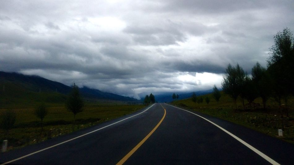 Road Sky The Way Forward Diminishing Perspective Landscape Scenics Cloud - Sky Nature Tranquility Tranquil Scene Transportation Outdoors Long Asphalt Grass Mountain Day Storm Cloud Beauty In Nature