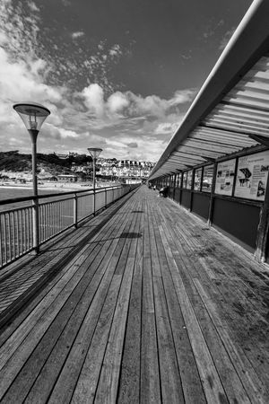 Boscombe Beach Pier Architecture Boardwalk Boscombe Pier  Bridge Bridge - Man Made Structure Building Exterior Built Structure City Cloud - Sky Connection Day Diminishing Perspective Direction Empty Footpath Long Nature No People Outdoors Railing Sky Surface Level The Way Forward Water Wood - Material