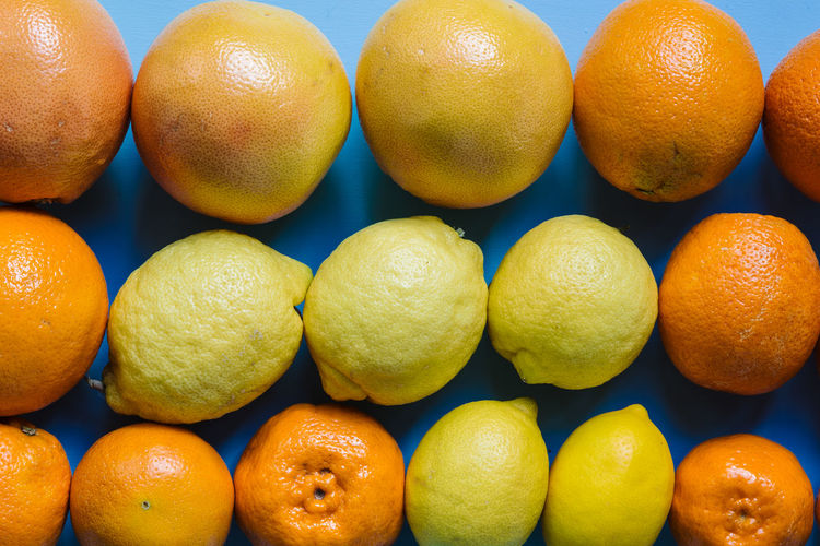 Backgrounds Citrus Fruit Close-up Day Farmer Market Food Food And Drink Freshness Fruit Full Frame Healthy Eating Indoors  Large Group Of Objects Lemon No People Orange - Fruit Orange Color Studio Shot Vitamin C Yellow