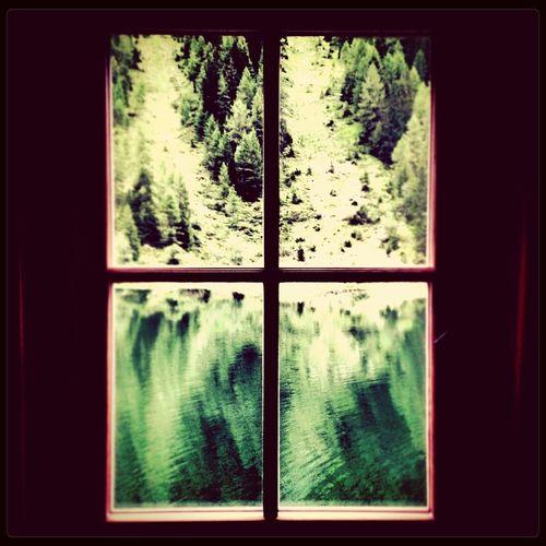 guardando dalla finestra uno scorcio di lago. a glimpse of lake out of the window. From My Window Lake View Mountains