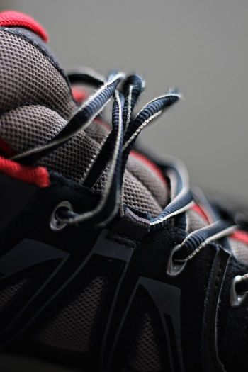 A Lace. Red Black Color Boot Boot Laces Close-up Clothing Communication Focus On Foreground Garment Gray Indoors  Laces No People Personal Accessory Safety Selective Focus Studio Shot Textile Walking Boot The Still Life Photographer - 2018 EyeEm Awards
