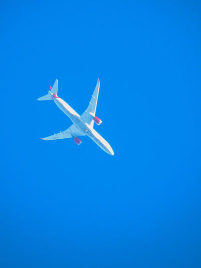 Virgin Atlantic Air Vehicle Airplane Blue Brand Clear Sky Day Flying Low Angle View Mid-air No Clouds No People Outdoors Sky Transportation Vapor Trail